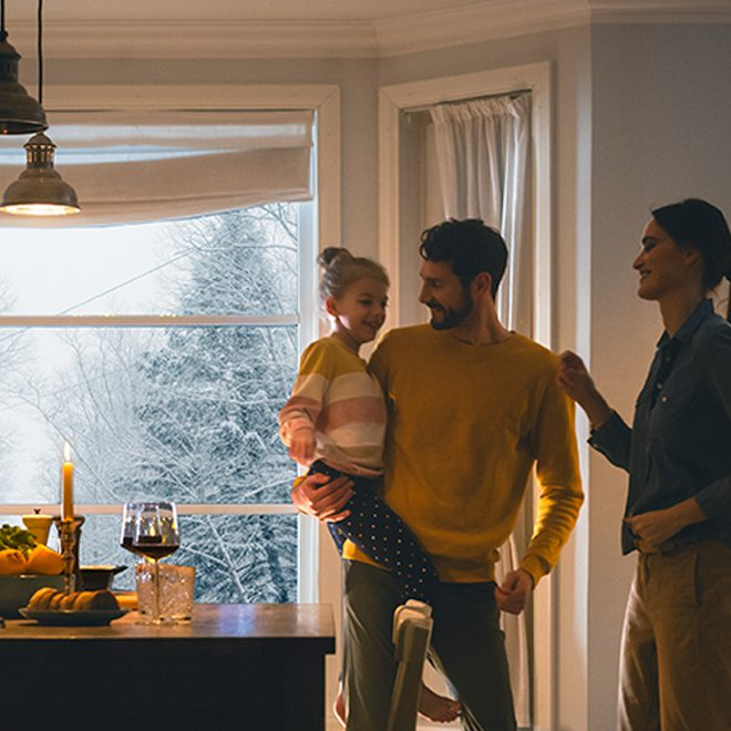 Family in a heated home during the winter with power